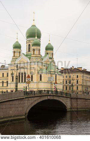 Griboyedov Canal Embankment With The Mogilyovsky Bridge And The St.isidore Church, The Church Of The