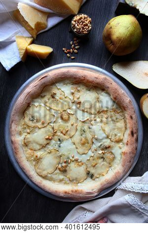 Pizza With Dried Pears And Pine Nuts. Traditional Italian Pizza. Metal Plate For Serving Pizza. A Pi