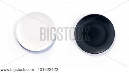 Empty Matte White And Black Plates Isolated On White Background Top View