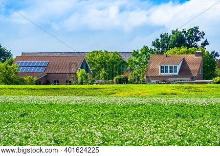 Country Side Landscape With Classical Dutch Homes In Waterlandkerkje, Zeeland, The Netherlands
