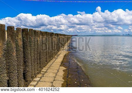 Scenery Of Breskens Beach With Beautiful Blue Sky And Wooden Wave Breakers, Zeeland, The Netherlands