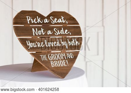 Shot Of Ceremony Signage, Pick A Seat Either Side On A Wedding Day With A Blurred Background
