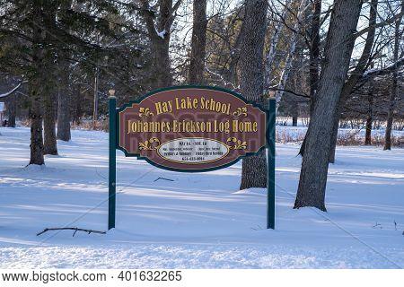 Scandia, Minnesota - January 2, 2021: Sign For The Hay Lake School And Historic Johannes Erickson Lo