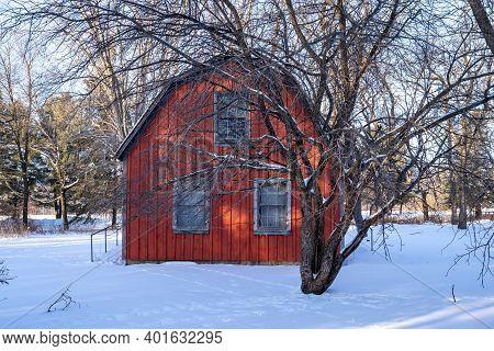 Scandia, Minnesota - January 2, 2021: Exterior Of The Historic Johannes Erickson Log Home, In Winter