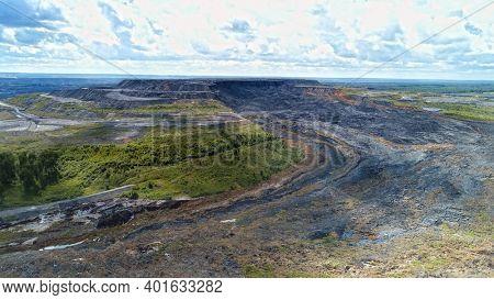Aerial landscape with coal mine. Environmental disaster - a coal mine dump landslide destroyed a river valley