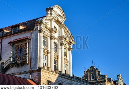 He Facade Of A Historic Tenement House With A Clock In Poznan