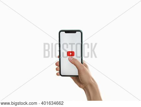 Mykolaiv, Ukraine - July 9, 2020: Woman Holding Iphone 11 With Youtube App On Screen Against White B