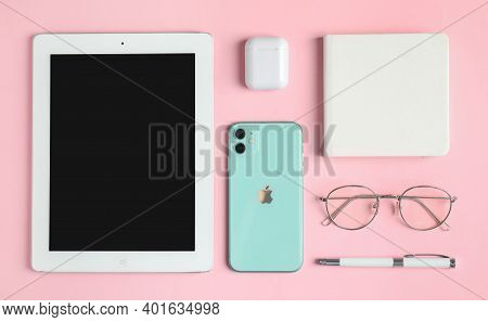 Mykolaiv, Ukraine - July 10, 2020: Flat Lay Composition With Iphone 11, Ipad Tablet And Airpods On P