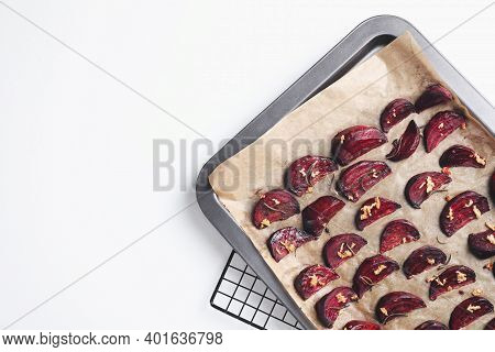 Baking Tray With Roasted Beetroot Slices On White Table, Top View. Space For Text