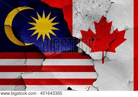 Flags Of Malaysia And Canada Painted On Cracked Wall