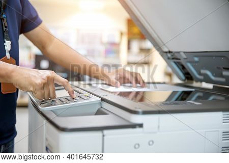 Close Up Hand Of Office Man Is Press Button On Panel And Put Paper On The Copier Machine In Copy Roo