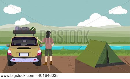 Traveling Of Open Grasslands And Riverside Scenery. Travel Vehicle With Various Luggage Accessories