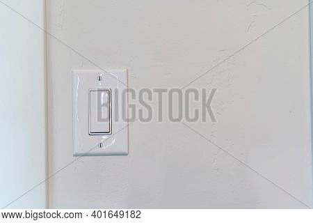 White Wall With Electrical Rocker Light Switch Inside The Room Of A House