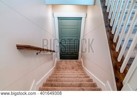 Interior U Shaped Staircase With Wall Mounted Handrail And Leads To The Basement