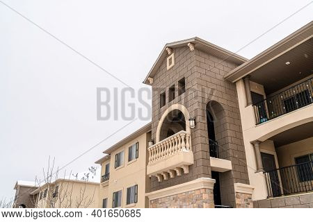 Apartment Building With Gabled Front Design Against A Cloudy Skyscape In Winter