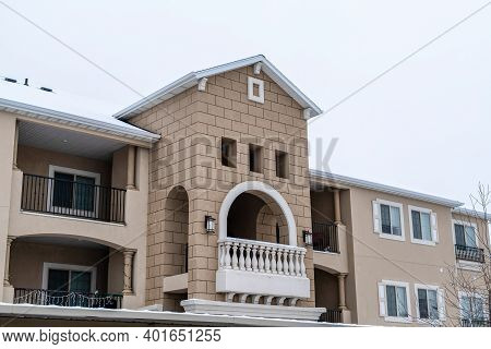 Residential Apartment Building Facade With Gabled Front Design And Balconies