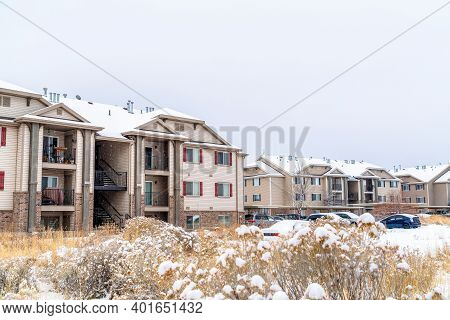 Apartment Buildings And Townhouses At A Snowy Neighborhood In Winter Season