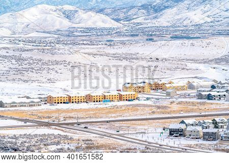 Apartments Townhouses And Homes On A Snowy Landscape With Scenic Mountain View