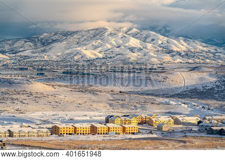 Townhouses Apartments And Homes Against Snow Covered Mountain View In Winter