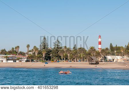 Swakopmund, Namibia - June 18, 2012: A Beach Scene At The Waterfront In Swakopmund. Palm Trees And T