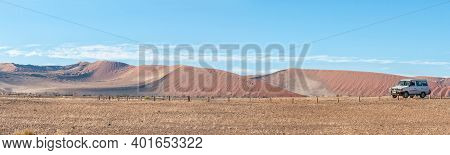 Sossusvlei, Namibia - June 23, 2012: Panoramic Dune Landscape Between Sesriem And Sossusvlei In Nami