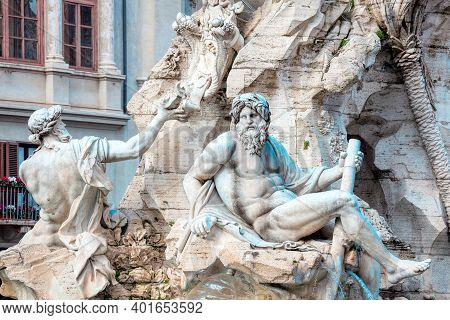 Sculptures Of Fontana Dei Quattro Fiumi Piazza Navona In Rome Italy . Sculptures Of Mythological God