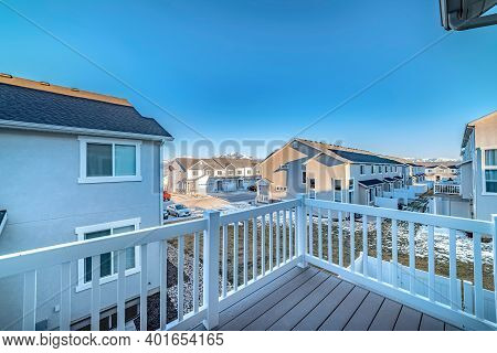 Townhouses At A Sunny Residential Neighborhood Viewed From The Deck Of A Home