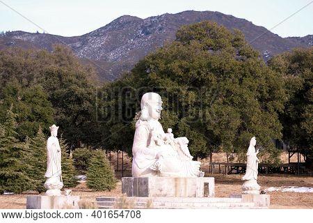 January 4, 2021 In Warner Springs, Ca:  Buddhist Sculptures At An Outdoor Spiritual Garden Taken At