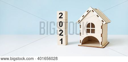 Home Loan Concept With Wood House Model On Table Background. Property Investment. Business Concept.