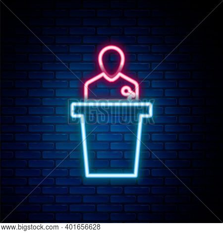 Glowing Neon Line Speaker Icon Isolated On Brick Wall Background. Orator Speaking From Tribune. Publ