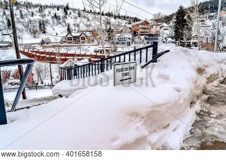 Mountain Town With Impassable Snowed In Outdoor Stairway On A Cloudy Winter Day