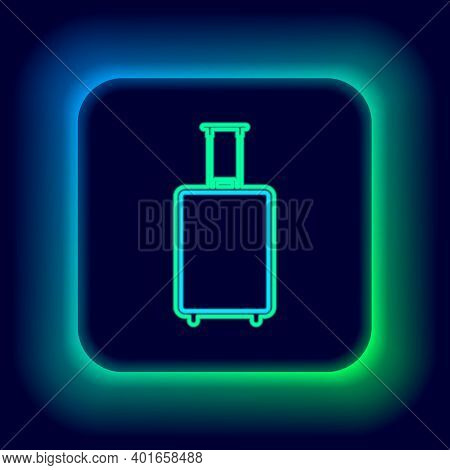 Glowing Neon Line Travel Suitcase Icon Isolated On Black Background. Traveling Baggage Sign. Travel
