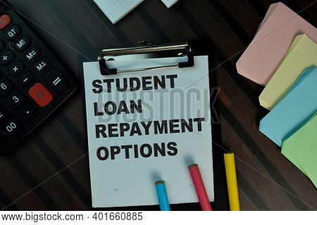 Student Loan Repayment Options Write On A Paperwork Isolated On Wooden Table. Educational Concept