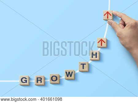 Wooden Blocks Arranged In Curve Shape With The Word Growth. Business Growth, Career Growth Or Growth