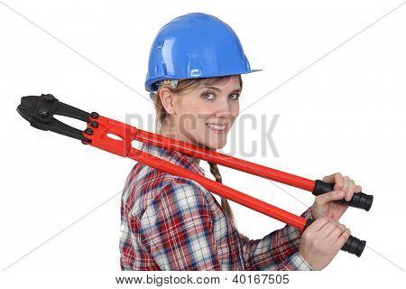 Tradeswoman holding boltcutters