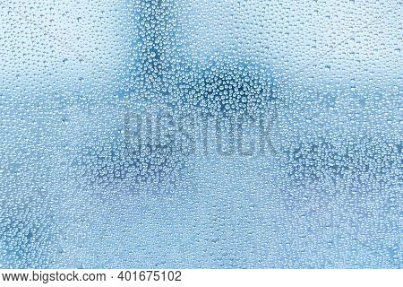 Wet Glass With Large Drops Of Water Or Rain Of Blue Color. Background Or Wallpaper With Water Textur