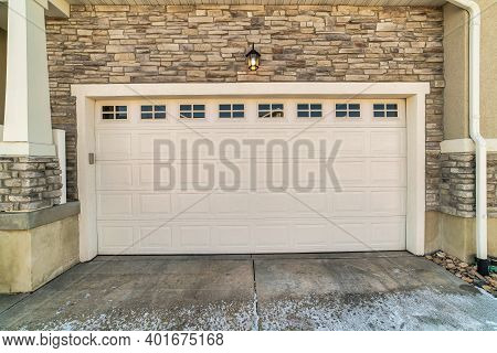 Focus On The Wide White Panelled Wooden Door With Glass Panes Of A Townhouse