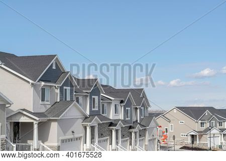 Peaceful Skyscape Of Blue Sky Over Suburban Houses On A Residential Landscape