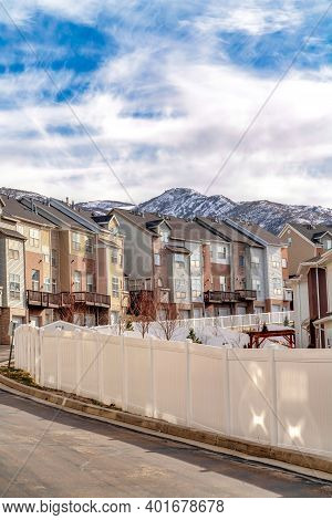 Wasatch Mountains Peak Towering Over Townhouses Ona Scenic Valley Neighborhood