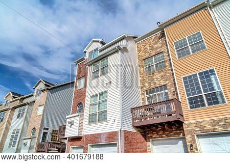 Townhouses On A Sunny Day Setting With Balconies Overlooking Scenic Skyscape