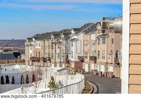 Utah Valley Scenic Neighborhood With Townhouses Against Blue Sky Background
