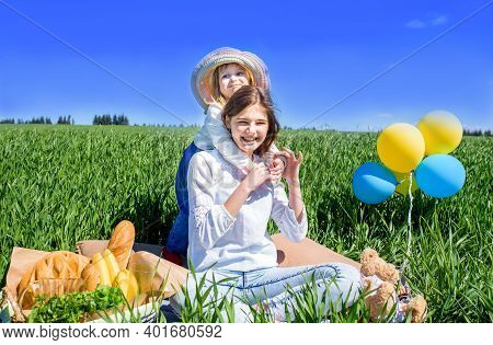Children In A Field On A Picnic. Bread And Fruit In A Basket. Sunny Summer Day. Teenager Girl 14 Yea