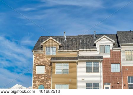 Townhouse With Snowy Peak Of Wasatch Mountains And Blue Sky Views In Background