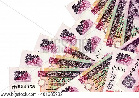 20 Sri Lankan Rupees Bills Lies In Different Order Isolated On White. Local Banking Or Money Making