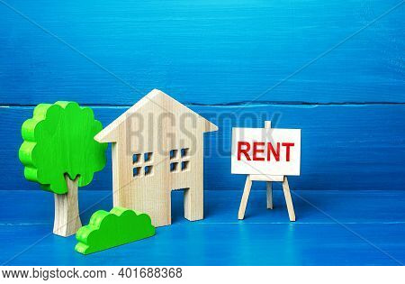 Residential Building Figurine And Easel Rent Sign. Search For Rental Housing. Real Estate Realtor Se