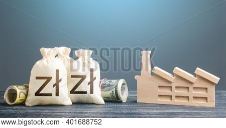 Polish Zloty Money Bags And Industrial Factory. Subsidies Support For Businesses. Investments In Pro