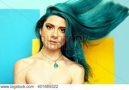 Young Sexy Woman With Flowing Bright Blue Hair On Geometric Background. Fashion Makeup. Beauty Portr