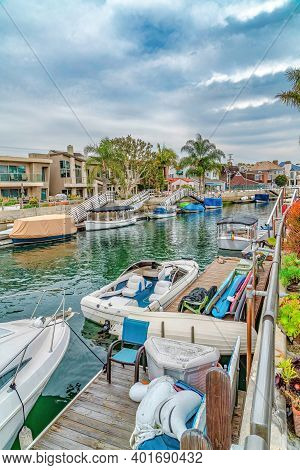 Leisure Boats On Public Canal Lined With Elegant Houses In Long Beach California
