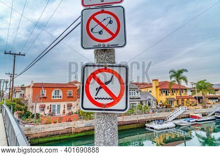 No Skateboarding And No Diving Signs At A Footbridge Over Canal In Long Beach Ca