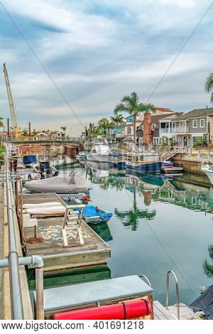 Boats And Docks On Canal With Footbridge In Long Beach California Neighborhood